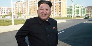 2014 Kim-Jong-Un-smiling-10-13